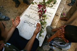 Palestinians visit the grave of Yasser Arafat's sister, Anam, in Khan Yunis, Palestinian Territories, Nov. 9, 2004. Arafat was diagnosed with liver failure while in critical condition in a Paris hospital.