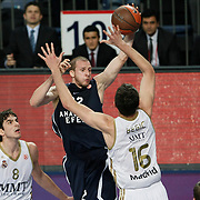Anadolu Efes's Sinan Guler (C) during their Turkish Airlines Euroleague Basketball Group C Game 10 match Anadolu Efes between Real Madrid at Sinan Erdem Arena in Istanbul, Turkey, Thursday, December 22, 2011. Photo by TURKPIX
