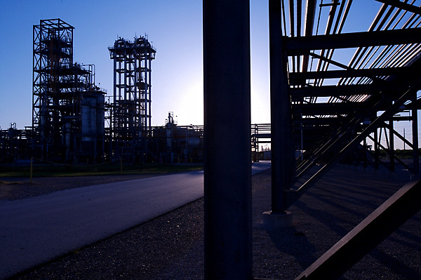 Stock photo of piping at a chemical plant at dusk