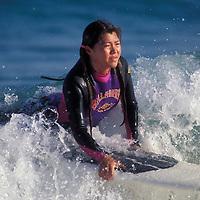 Australia, New South Wales, Sydney, Surfer Kazuyo Hasegawy rides wave into Bondi Beach