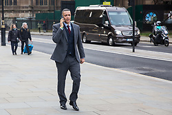 London, UK. 16 December, 2019. Clive Lewis, the Labour MP for Norwich South who is said to be considering standing as a Labour leadership candidate, walks outside the Palace of Westminster as Parliament resumes following the general election.