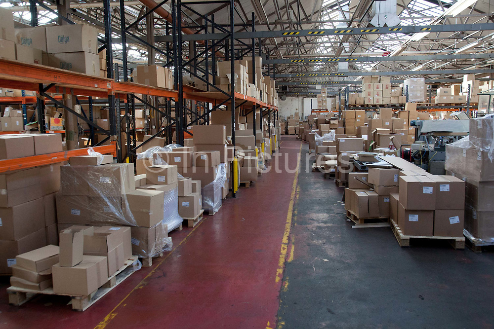 Wide shot of vinyl record distrbution centre warehouse, with boxes of disks before distribution. The Vinyl Factory is the old EMI vinyl works in Uxbridge, Middlesex, producing limited edition vinyls of new releases, plus re-presses of classics. They also act as a distributor of vinyl releases.