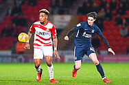 Mallik Wilks of Doncaster Rovers (7) under close attention from Sam Hart of Southend United (42) during the EFL Sky Bet League 1 match between Doncaster Rovers and Southend United at the Keepmoat Stadium, Doncaster, England on 12 February 2019.