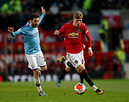 Brandon Williams of Manchester United goes past Bernardo Silva of Manchester City during the Premier League match at Old Trafford, Manchester. Picture date: 8th March 2020. Picture credit should read: Darren Staples/Sportimage