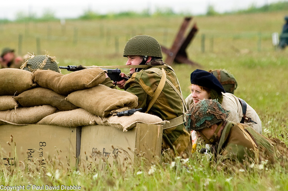 Members of the Northern World War Two Association. Portraying 22nd Independent Company, 6th Airborne Parachute Regiment supported by members of Resistance and Combined Operation group give covering fire during a large scale Western Front  battle reenactment. .Scarborough Castle Saturday 29th May 2010 .Images © Paul David Drabble.