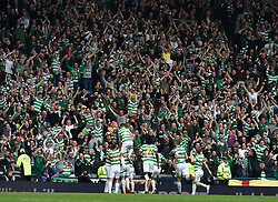 Celtic players celebrate in front of their fans after Celtic's Moussa Dembele scored from the penalty spot during the William Hill Scottish Cup semi final match at Hampden Park, Glasgow.