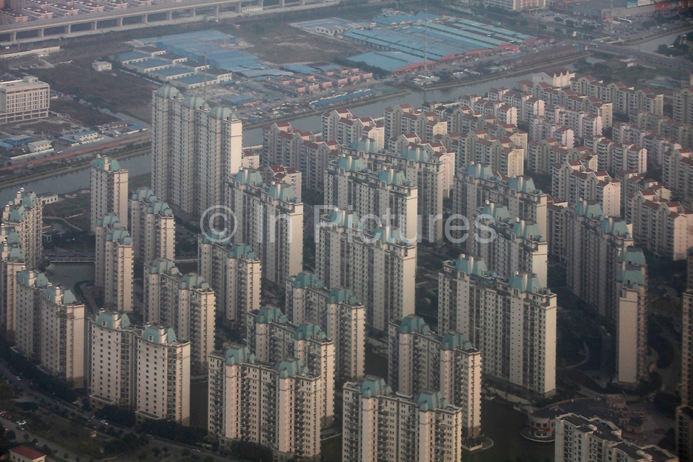 A aerial view of densly built apartment complexes that dominates the lanscape in Shanghai, China  Nov. 14, 2011. China has for the first time in its long history to have more urban residents than their rural counterparts, and the process it expected to continue and becomes the next growth engine for China's economy.