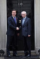 © licensed to London News Pictures. London, UK 25/10/2012. David Cameron (L) and European Council president Herman van Rompuy posing in Downing Street on 25/10/12. Photo credit: Tolga Akmen/LNP