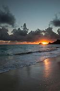 Sun rising behind the Mokulua Islands, Kailua Bay, Oahu, Hawaii