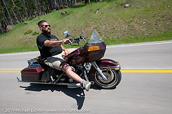 Derek Spitsnogle riding his Harley bagger on the Cycle Source Ride up Vanocker Canyon to Nemo during the Sturgis Black Hills Motorcycle Rally. SD, USA. Wednesday, August 7, 2019. Photography ©2019 Michael Lichter.