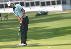 July 15, 2018 - Silvis, Illinois, U.S. - SILVIS, IL - JULY 15:  Michael Kim sinks his final putt on the #18 green during the final round of the John Deere Classic on July 15, 2018, at TPC Deere Run, Silvis, IL.  (Photo by Keith Gillett/Icon Sportswire) (Credit Image: © Keith Gillett/Icon SMI via ZUMA Press)