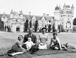 File photo dated 08/09/60 of the Queen, the Duke of Edinburgh and three of their children Princess Anne, Prince Charles and baby Prince Andrew, on his father's knees on the lawns at Balmoral. Balmoral in the Highlands, one of the royals' favourite places, held many memories for the Duke of Edinburgh. The Queen was once said to never be happier than when she was at Balmoral, Philip, too, loved the outdoor life that was synonymous with their annual break, which stretched from the end of July into October. Issue date: Friday April 4, 2021.