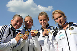 NICOLE REINHARDT & CONNY WASSMUTH & TINA DIETZE & KATRIN WAGNER - AUGUSTIN (ALL GERMANY) POSE WITH THEIR GOLD MEDALS AFTER WOMEN'S K1 RELAY 200 METERS FINAL A RACE DURING 2010 ICF KAYAK SPRINT WORLD CHAMPIONSHIPS ON MALTA LAKE IN POZNAN, POLAND...POLAND , POZNAN , AUGUST 22, 2010..( PHOTO BY ADAM NURKIEWICZ / MEDIASPORT ).