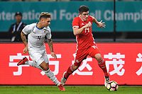 """Declan John, right, of Wales national football team kicks the ball to make a pass against Guillermo Varela of Uruguay national football team in their final match during the 2018 Gree China Cup International Football Championship in Nanning city, south China's Guangxi Zhuang Autonomous Region, 26 March 2018.<br /> <br /> Edinson Cavani's goal in the second half helped Uruguay beat Wales to claim the title of the second edition of China Cup International Football Championship here on Monday (26 March 2018). """"It was a tough match. I'm very satisfied with the result and I think that we can even get better if we didn't suffer from jet lag or injuries. I think the result was very satisfactory,"""" said Uruguay coach Oscar Tabarez. Wales were buoyed by a 6-0 victory over China while Uruguay were fresh from a 2-0 win over the Czech Republic. Uruguay almost took a dream start just 3 minutes into the game as Luis Suarez's shot on Nahitan Nandez cross smacked the upright. Uruguay were dealt a blow on 8 minutes when Jose Gimenez was injured in a challenge and was replaced by Sebastian Coates. Inter Milan's midfielder Matias Vecino of Uruguay also fired at the edge of box from a looped pass but only saw his attempt whistle past the post. Suarez squandered a golden opportunity on 32 minutes when Ashley Williams's wayward backpass sent him clear, but the Barca hitman rattled the woodwork again with goalkeeper Wayne Hennessey well beaten."""