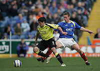 Photo: Lee Earle.<br /> Portsmouth v Manchester City. The Barclays Premiership. 11/03/2006. City's Claudio Reyna (L) battles with Sean Davis.