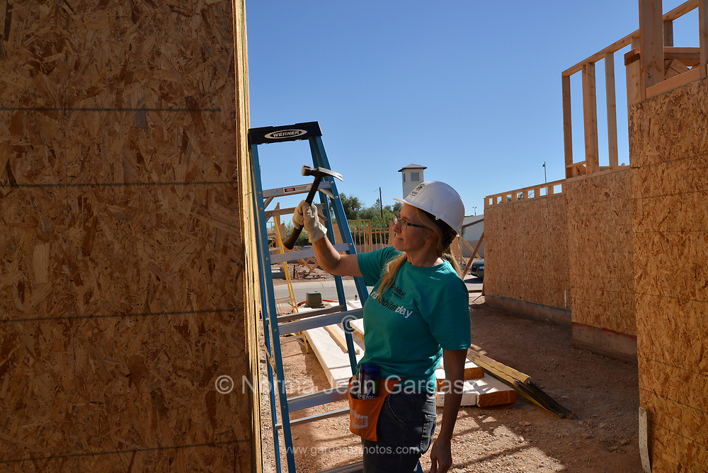 """Sherry Tilton works off 200 hours of """"sweat equity"""" at the Amphi construction site toward home ownership through Habitat for Humanity.  Tilton and her 28-year-old daughter will move from an apartment complex to their home in 2020.  Credit: Norma Jean Gargasz"""