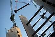 Steel girder is lifted onto a contruction site by crane in the City of London, UK. A great deal of high rise buildings are going up in the city as the height of the area changes.