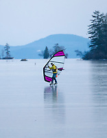 Ice Sailing across Center Harbor Bay on Lake Winnipesaukee Wednesday afternoon.  (Karen Bobotas/for the Laconia Daily Sun)