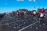 Spring Lake, NJ -- May 27, 2017. Discarded water cups in the wake of the runners
