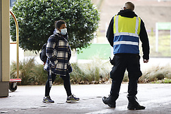 © Licensed to London News Pictures. 16/02/2021. London, UK. A Passenger arrives for quarantine at a Holiday Inn hotel near Heathrow Airport for the second day. People entering the UK from a 'red list' of 33 high risk countries will have to quarantine at hotels for 10 days to try and stop new coronavirus variants entering the country. Photo credit: Peter Macdiarmid/LNP