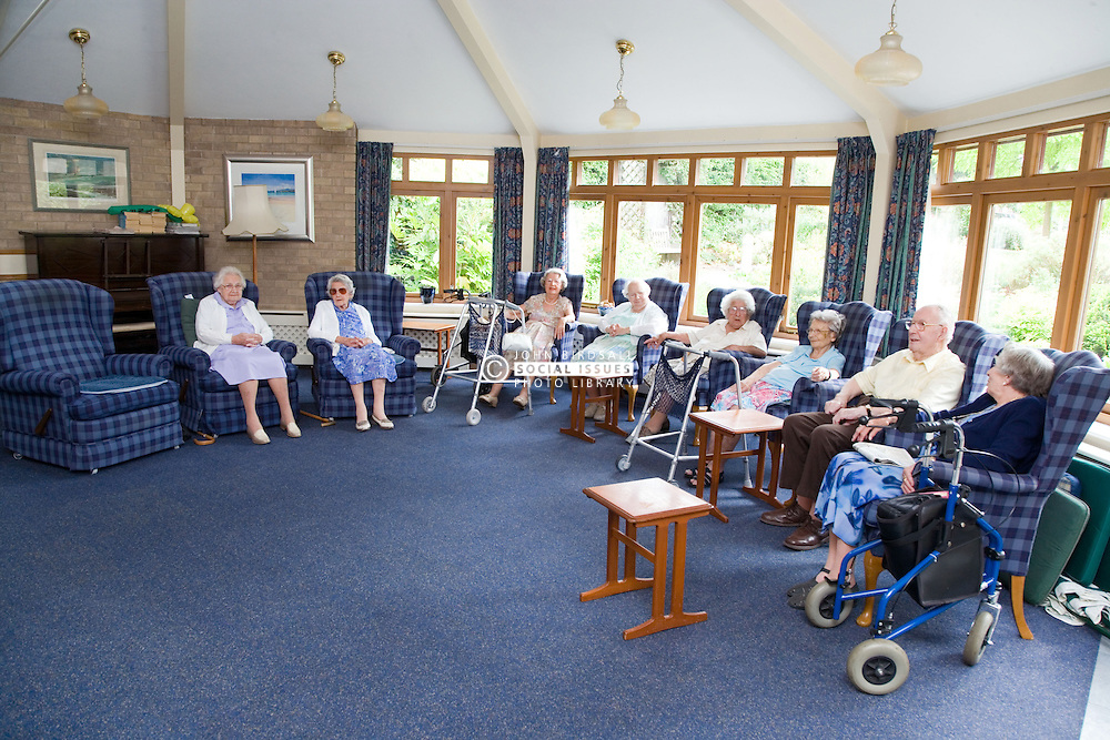 A group of older people relaxing in the communal lounge of a warden aided home,