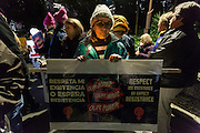A woman holds a sign calling for the respect of reproductive rights protest march by members of the Democratic Party Abroad organisation to mark the inauguration of President Donald Trump, Tokyo, Japan. Friday January 20th 2017 Around 400 people took apart in the march, which started in Hibiya Park at 6:30pm and finished in Roppongi just before 8pm, to honour the service given by President Obama and to protest against the illiberal policies expected of the new administration of President  Trump.