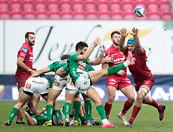 Benetton Rugby's Giorgio Bronzini gets the ball away despite pressure from Scarlets' Tadhg Beirne<br /> <br /> Photographer Simon King/Replay Images<br /> <br /> EPCR Champions Cup Round 3 - Scarlets v Benetton Rugby - Saturday 9th December 2017 - Parc y Scarlets - Llanelli<br /> <br /> World Copyright © 2017 Replay Images. All rights reserved. info@replayimages.co.uk - www.replayimages.co.uk