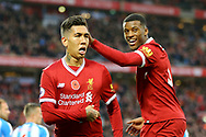 Roberto Firmino of Liverpool (l) celebrates with his teammate Georginio Wijnaldum after scoring his teams 2nd goal. Premier League match, Liverpool v Huddersfield Town at the Anfield stadium in Liverpool, Merseyside on Saturday 28th October 2017.<br /> pic by Chris Stading, Andrew Orchard sports photography.