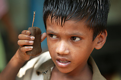SUBHAKANTA SETHI 5 years old has made a mobile phone shaped toy with clay dug from a nearby pit. This class has an opportunity to mould and make figures or fun toys with the clay, which can be left to dry in the sun.  KATAKPADA Village is low caste with many people being labourers although some do have greater resources and keep animals.  Prem assists this village kindergarten.