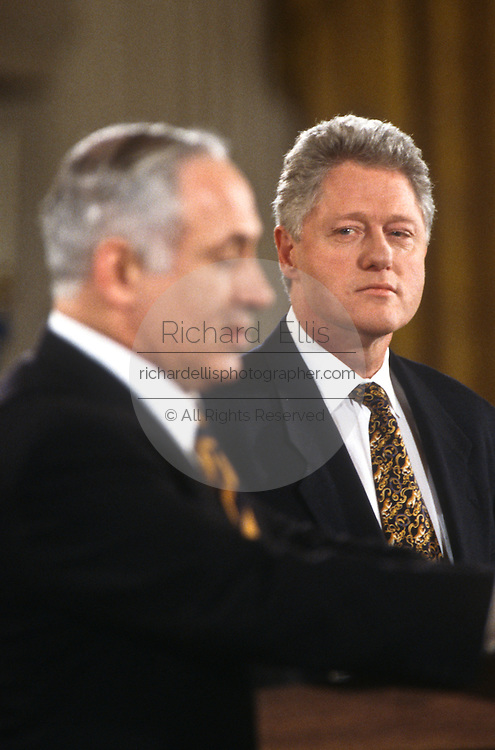 US President Bill Clinton looks toward Israeli Prime Minister Benjamin Netanyahu during a joint press conference February 13, 1997 In Washington, DC.