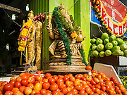 27 DECEMBER 2015 - SINGAPORE, SINGAPORE:   Tomatoes for sale at a produce shop on Buffalo Road across from Tekka Market. First opened in 1915, the market was moved to its present location in 1982 and renovated in 2009. It is one of the most famous hawker stall (street food) areas in Singapore.      PHOTO BY JACK KURTZ