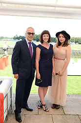 Left to right, JON ZAMMETT, ALEXANDRA ROACH and REMY BEASLEY at the Audi International Polo at Guards Polo Windsor Great Park, Egham, Surrey on 28th July 2013.