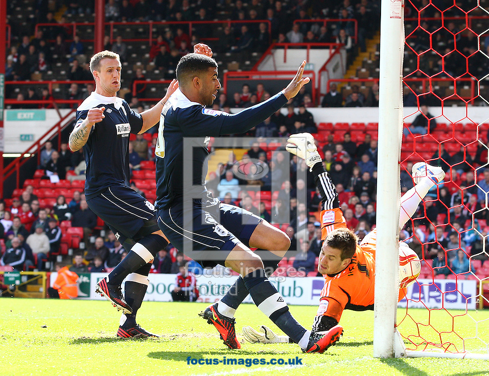 Picture by Paul Terry/Focus Images Ltd +44 7545 642257.27/04/2013.Tom Heaton ( R ), goalkeeper of Bristol City can not stop the goal of James Vaughan ( not pictured) of Huddersfield Town as Oscar Gobern ( C ) makes sure it goes in, during the npower Championship match at Ashton Gate, Bristol.