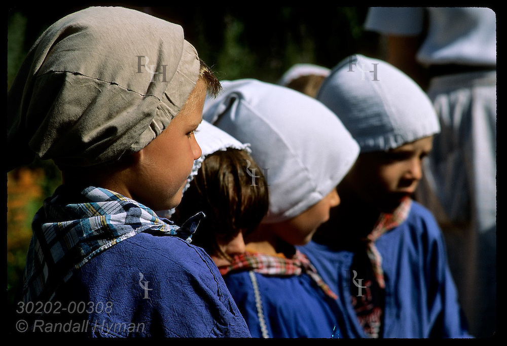 Boys dressed like peasants stand in row @ Ecomusee folk museum on a field trip; Ungersheim, Alsace France