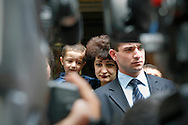 Woman with child  listening to Nagorno-Karabakh de-facto President Arkady Ghoukassian talking to the press after he casts his vote for a new president on at a polling station in a Stepanakert theater. ..