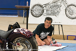 Japanese artist Makoto Endo (of Brooklyn) working on one of his motorcycle paintings using chop sticks instead of brushes, as he has become known, in the Thunderdome at the 2016 ROT (Republic of Texas Rally). Austin, TX, USA. June 10, 2016.  Photography ©2016 Michael Lichter.