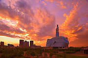 Canadian Museum for Human Rights (CMHR) with the city of Winnipeg in background at sunset<br /> Winnipeg<br /> Manitoba<br /> Canada