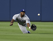 ATLANTA, GA - AUGUST 12:  Centerfielder Yasiel Puig #66 of the Los Angeles Dodgers dives unsuccessfully to catch a fly ball during the third inning of the game against the Atlanta Braves at Turner Field on August 12, 2014 in Atlanta, Georgia.  (Photo by Mike Zarrilli/Getty Images)