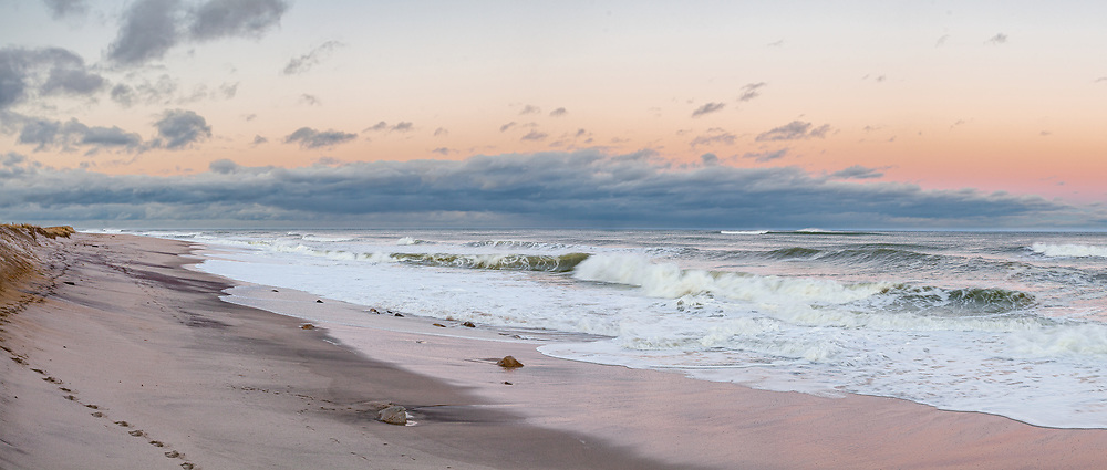 A passing storm leaves wave washed sand at Nauset Beach.