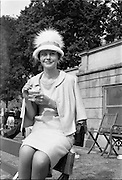 """06/06/1962<br /> 06/06/1962<br /> 06 June 1962<br /> College Races at Trinity College, Dublin. Strawberries and cream for Etain Yardley  a student at T.C.D. who won the """"Miss Elegance"""" competition at the College Races at College Park, Dublin."""