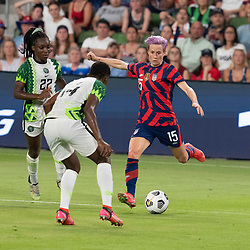 USA's MEGAN RAPINOE (15) challenges CHIDINMA OKEKE (14) of Nigeria as the US Women's National Team (USWNT) beats Nigeria, 2-0 in the inaugural match of Austin's new Q2 Stadium. The U.S. women's team, an Olympic favorite, is wrapping up a series of summer matches to prep for the Tokyo Games.