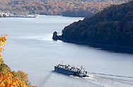 Cortlandt Manor, NY - A tugboat pushes a barge down the Hudson River south of the Bear Mountain Bridge on Nov. 2, 2008.