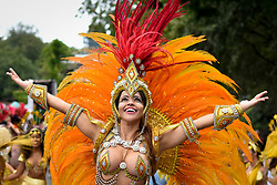 © Licensed to London News Pictures. 27/08/2018. LONDON, UK. A performer takes part in The Grand Finale parade at the Notting Hill Carnival.  Over one million revellers are expected to visit Europe's biggest street party over the Bank Holiday Weekend in a popular annual event celebrating Caribbean culture.  Photo credit: Stephen Chung/LNP