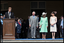 May 22, 2018 - London, London, United Kingdom - Image licensed to i-Images Picture Agency. 22/05/2018. London, United Kingdom. The Duke of Sussex gives a speech watched by the Prince of Wales, Duchess of Cornwall and the Duchess of Sussex at the Prince of Wales' 70th Birthday Patronage Celebration in the gardens of  Buckingham Palace in London. (Credit Image: © Stephen Lock/i-Images via ZUMA Press)