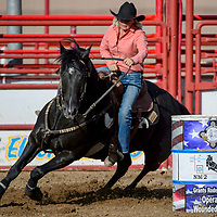 Barrel racer Marlene McGaughey rounds her second barrel in the Grants Senior Rodeo Thursday at the Grants Rodeo Arena.