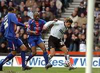 Photo: Leigh Quinnell.<br /> Derby County v Crystal Palace. Coca Cola Championship. 25/03/2006. Derbys Ingigo Idiakez has a shot at goal watched by Crystal Palaces Emmerson Boyce.