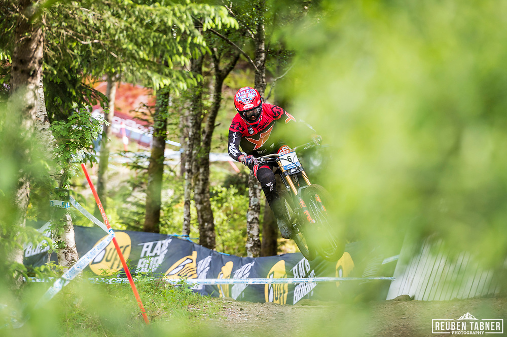 Neko Mulally of The YT Mob takes flight during his race run at the UCI Mountain Bike World Cup in Fort William.