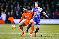 Luton Town midfielder Pelly-Ruddock Mpanzu and Wycombe Wanderers midfielder Matthew Bloomfield challenge for the ball during the EFL Sky Bet League 1 match between Luton Town and Wycombe Wanderers at Kenilworth Road, Luton, England on 9 February 2019.