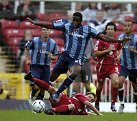 Photo: Jonathan Butler.<br /> Swindon Town v Charlton Athletic. The Carling Cup. 14/08/2007.<br /> Jose Semedo of Charlton jumps the tackle from Steve Adams.