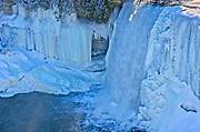 The Kagawong River flows over icy Bridal Veil Falls. Manitoulin Island<br />Kagawong<br />Ontario<br />Canada